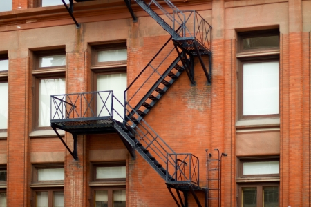 building external: External fire escape staircase on an old brick building Stock Photo