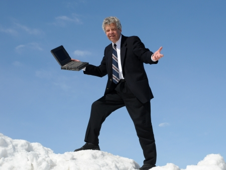 Businessman with a computer on a mountain Stock Photo