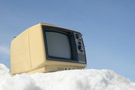 Portable vintage TV on a ski hill