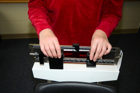 Woman setting up a weigh scale