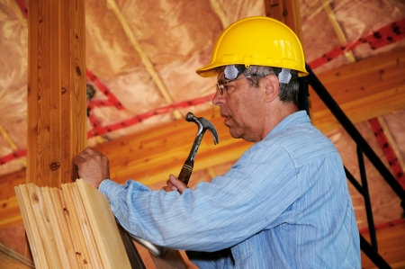 attic: Construction worker with a hammer