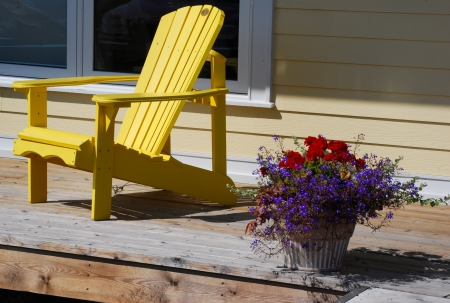 adirondack: Yellow chair and a flower pot