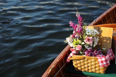 Picnic basket with flowers and bottle of wine