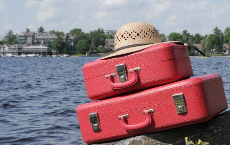 Two red suitcases and sun-hat at a vacations resort