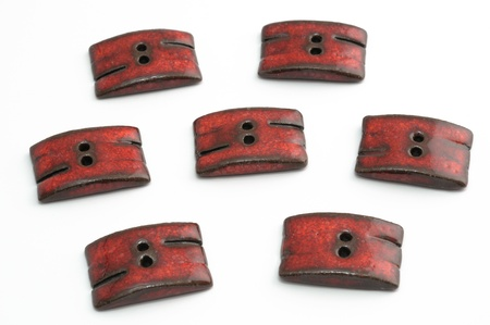 Red ceramic buttons