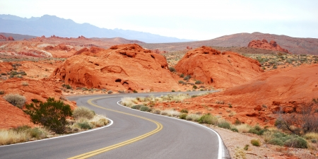 red mountain open space: Driving in Valley Of Fire Stock Photo