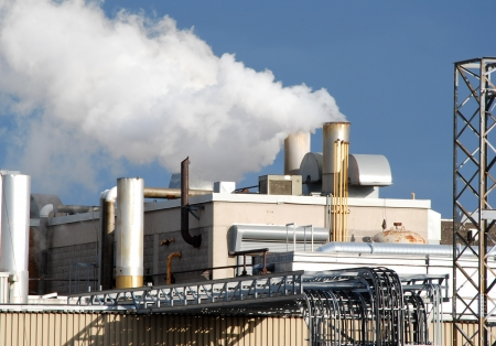 spewing: Manufacturing plant spewing pollution Editorial