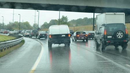 Car traffic in the rain Editorial