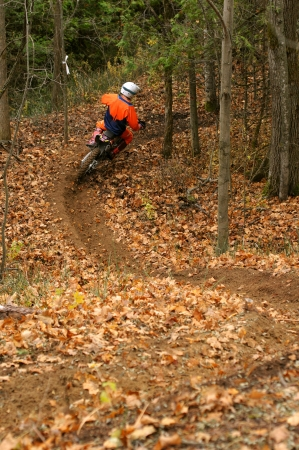 dirt: Motocross rider on a winding trail