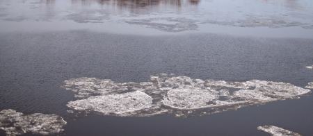 Fast flowing river with broken ice floes Stock fotó