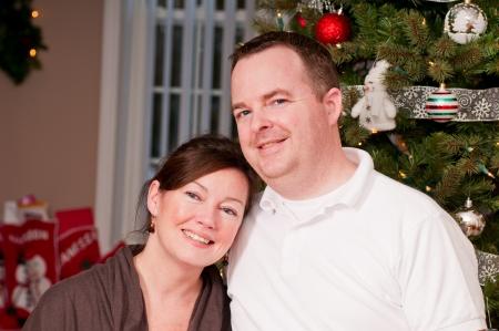 Happy couple beside a Christmas tree
