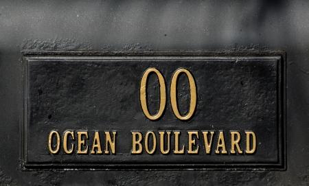 Black mailbox with Ocean Boulevard sign Stock Photo