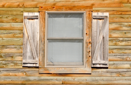 Simple window on wooden wall Stock Photo