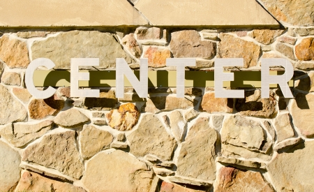 Center Sign with shadows on rock wall