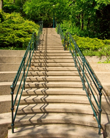 Stairs with green railing