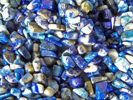 Lazurite background. Sparkling gem stones. Close up.