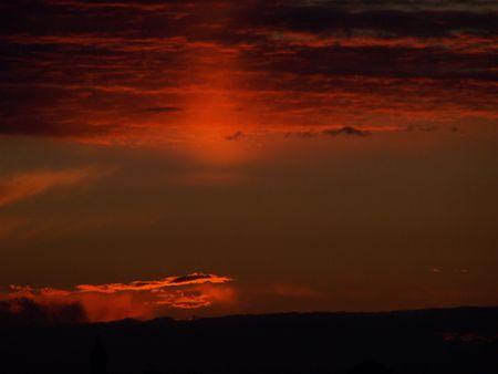 Dramatic sunset. Last rays of hidden sun photo
