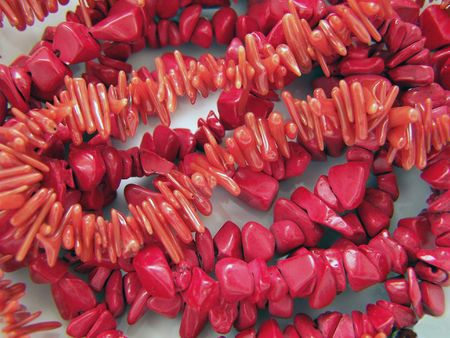accessorize: Close up of different red coral gems.
