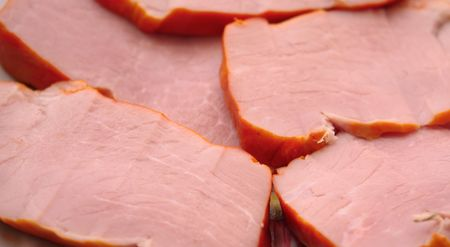 Close up of the pork meat slices. Background.