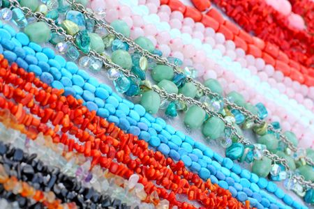 Close up of the different beads made of gemstones Stock Photo