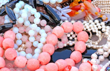 sard: Close up of different beads made of corals, pearls and gems