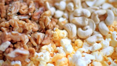 snack: Close up of the cashew, walnuts and popcorn for snack Stock Photo