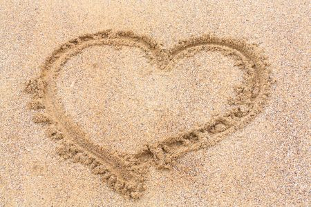 Heart on the wet sand Stock Photo