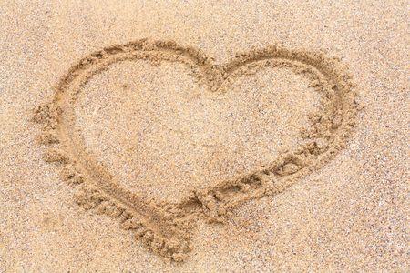 Heart on the wet sand Stock Photo