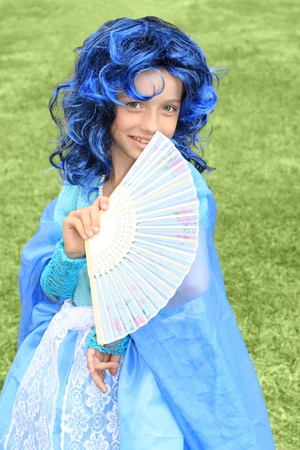 Portrait of the girl in blue wig. fairytale topic photo