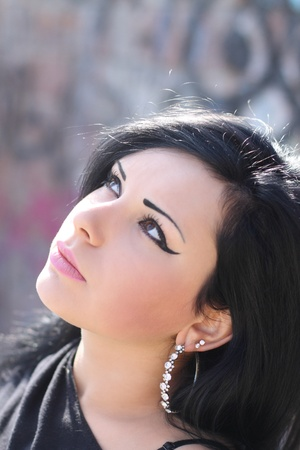 womanliness: Portrait of the beautiful woman looking upwards Stock Photo