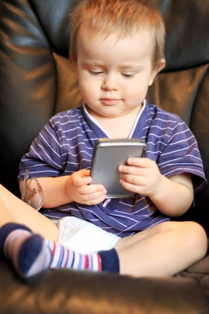 Portrait of the funny baby holding calculator Stock Photo - 14186615
