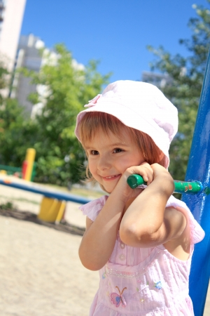 Little girl smiling. Portrait. On the playground. Stock Photo - 14620115