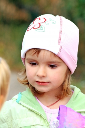 Portrait of the little lovely girl seriously talking to somebody Stock Photo - 15422987