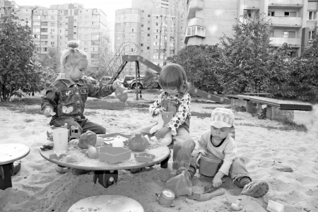 Portrait of the lovely little kids playing at the playground Stock Photo - 15812725