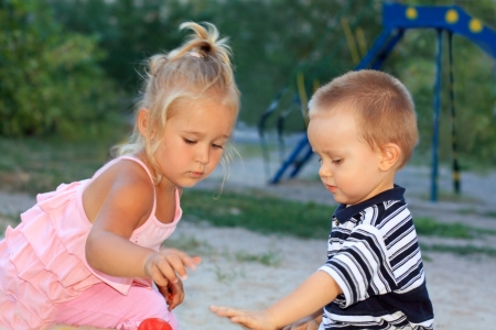 Portrait of the little lovely children playing in the sandbox Stock Photo - 16300634