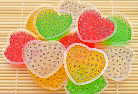 hoary: Colorful Thai dessert hearth jelly with hoary basil on  rolling mat