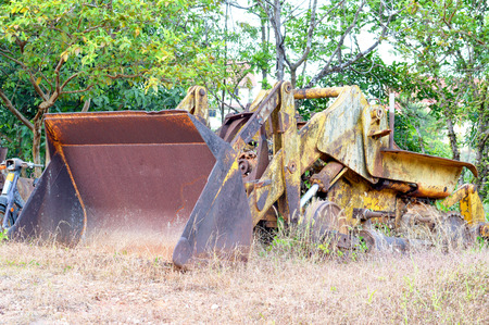 loaders: old Backhoe loaders in forest Stock Photo