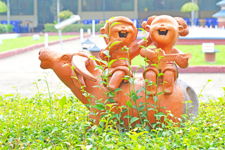stature: pottery Thailand childs and buffalo Stock Photo