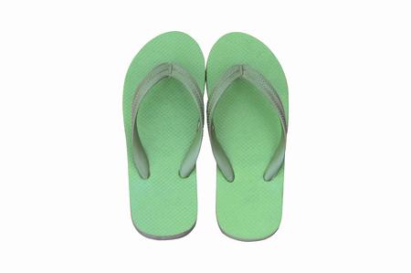 sandal: sandalia verde aislado en el fondo blanco Foto de archivo