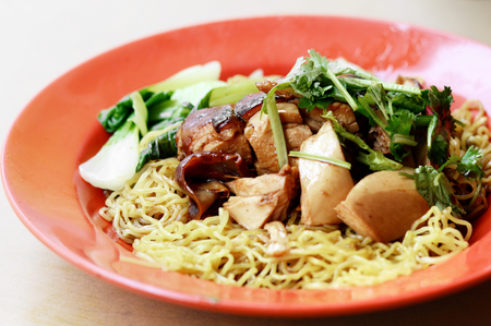 duck with noodles on red dish,  duck noodles Stock Photo