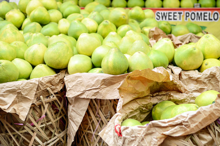 Photo of sweet pomelo for sale in the market. Stock Photo