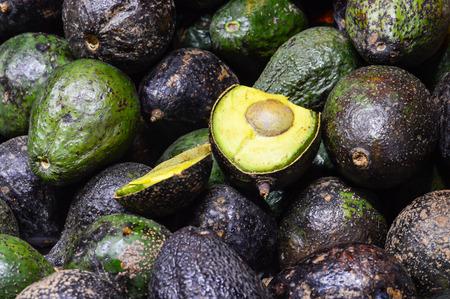 Photo of green Avocados. Avocado background. Fresh green avocado on a market.