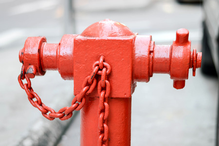 A closeup to a red fire hydrant.