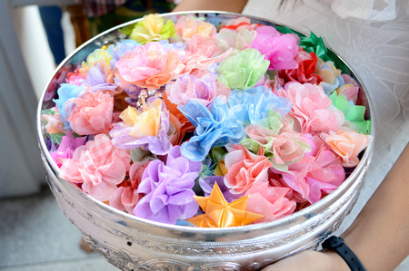 Alms flowers, almsgiving with flowers, Thai culture.