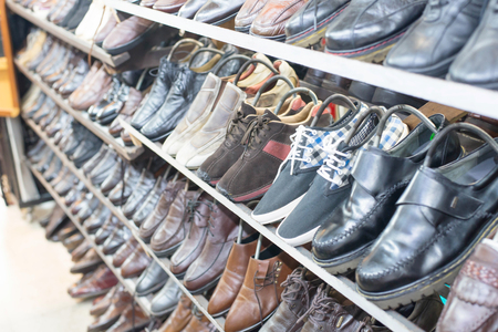 second floor: Shop of second hand shoes with chair for to wear shoes. many used shoes.