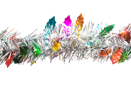 christamas: Closeup silver tinsel and colorful leaves christmas tree on white background. hanging for Christmas decoration.