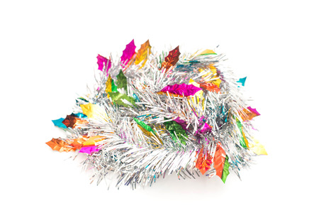 christamas: Silver tinsel and colorful leaves christmas tree on white background. hanging for Christmas decoration. Stock Photo