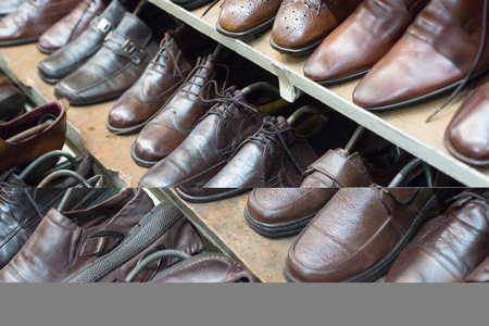 second floor: Closeup of shoes in second hand leather shoes shop. Many used shoes for sale.
