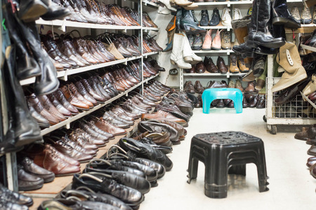 second floor: Shop of second hand shoes for sale. Stock Photo