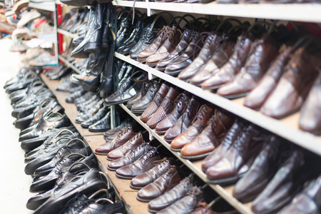second floor: Shop of second hand leather shoes. Many used shoes for sale.